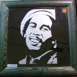 Etched glass mirror featuring portrait of smiling Bob Marley