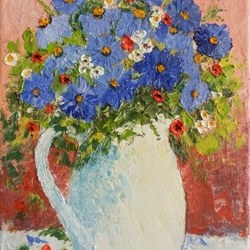 Blue flowers in a white vase
