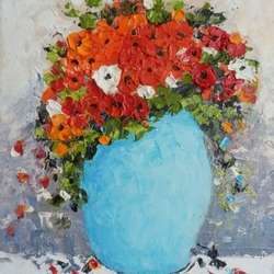 Red flowers in blue pot