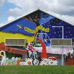 Large community arts mural on the side of a building.