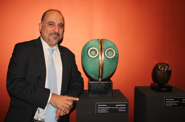 Adel Al Abbasi with his sculptures: The Blind Owl