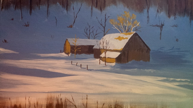 Winter barn in sunlight
